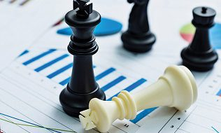 Chess Pieces On Business Chart Background